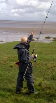 Chris Bowman from Borderlines: Demonstrating how to use a sea rod before a session on the Solway Firth